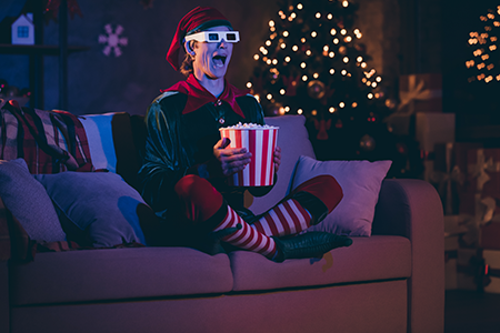 person dressed as an elf watching films