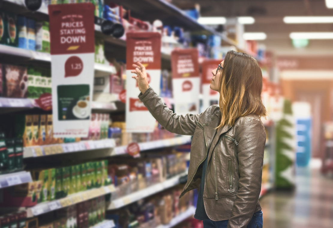 Shot of a young woman shopping at a grocery store
