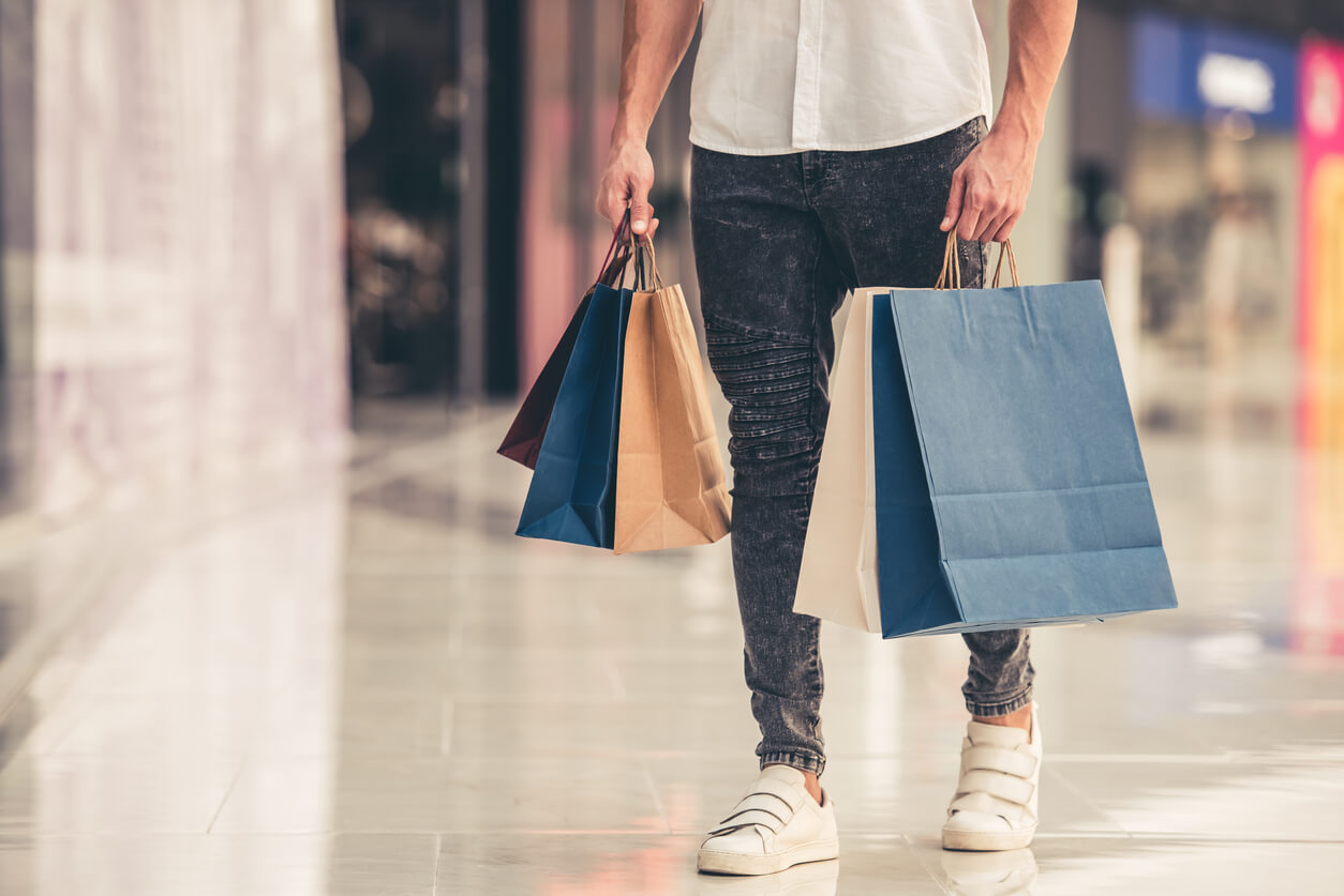 student with shopping bags
