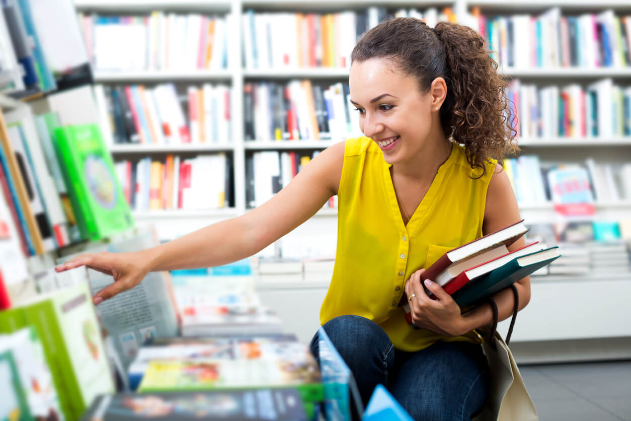 student shopping for books